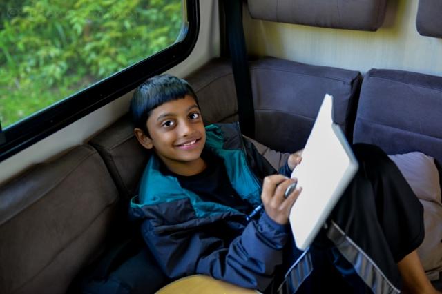 Danny journaling in the Campervan