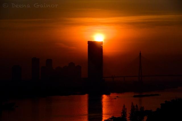 Sun rising in Bangkok as we left